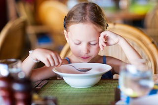 Little girl eating breakfast