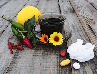 Warm tea, lemon, peppers, marigold, natural treatment vs pills
