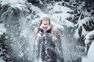 Winnter girl and snow fir tree.