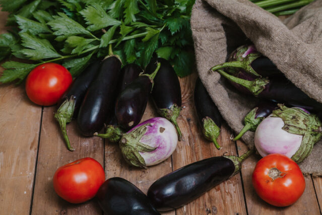 bag of nightshade vegetables including tomatoes and eggplants