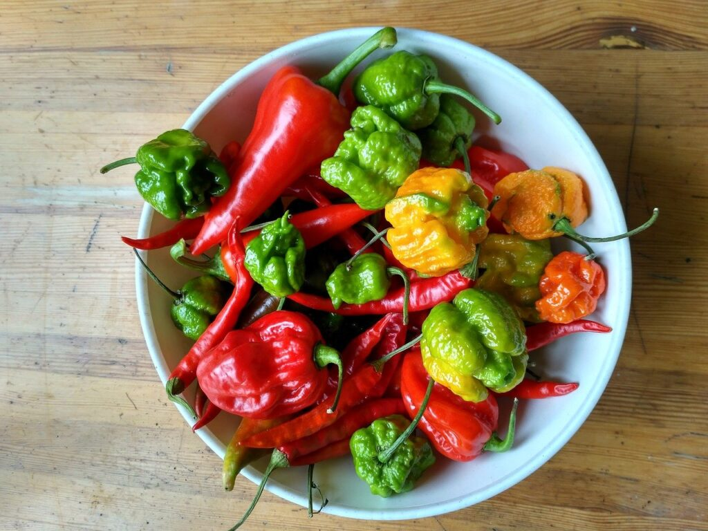 assorted hot peppers in a bowl including carolina reaper