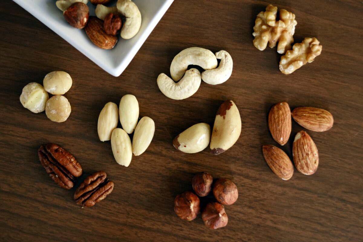 assorted nuts on a table containing omega-3 and omega-6 fats
