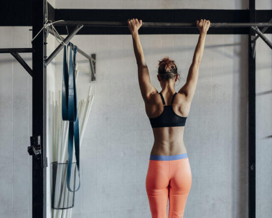 Women performing dead hangs for Pull-up training