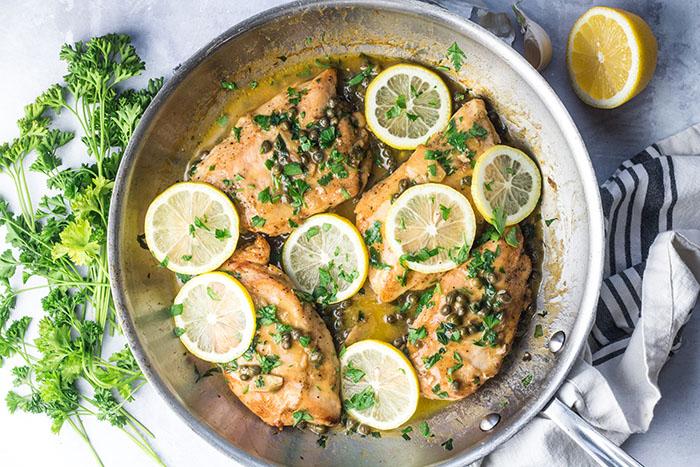 cooking gluten free lemon caper chicken recipe in a pan