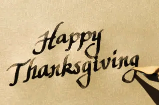 Fountain pen writing the words Happy Thanksgiving