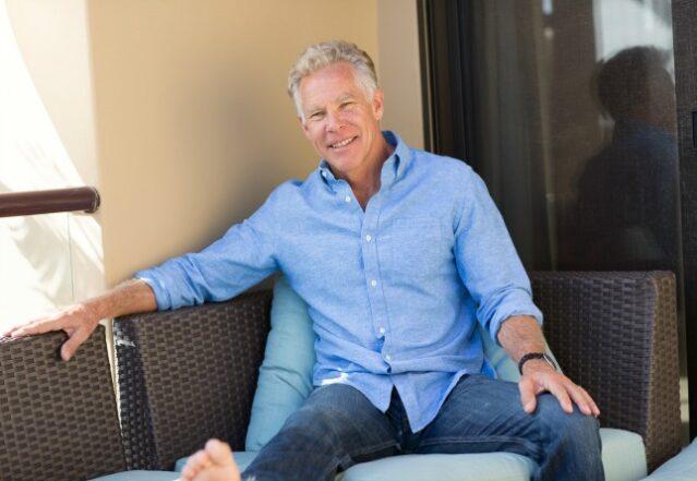 Mark Sisson sitting in a blue shirt