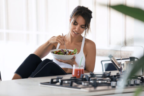 woman eating plant based low carb in the kitchen