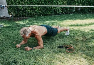 Mark Sisson doing a plank outside