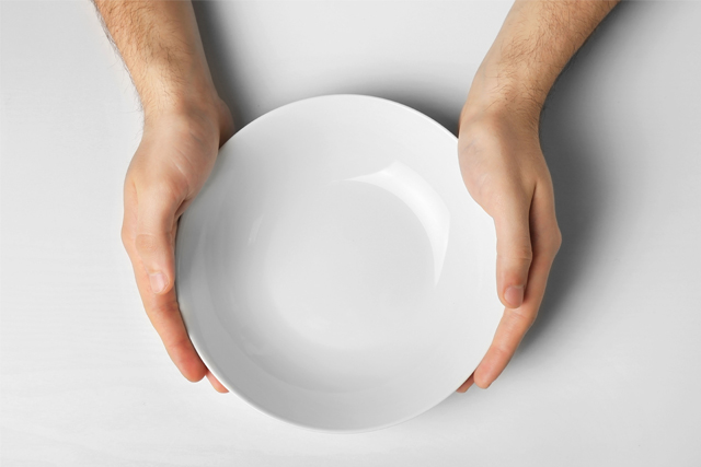 hands holding empty plate