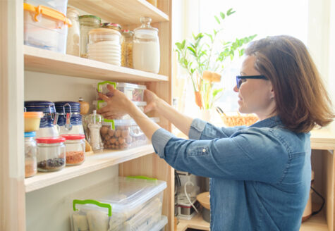 woman stocking her pantry