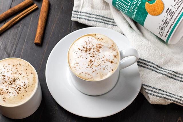latte in a mug with cinnamon sprinkled on top
