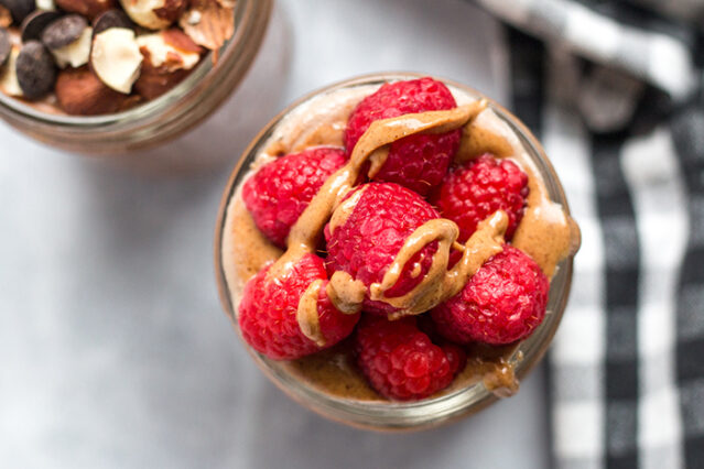 raspberry almond butter chia seed pudding finished recipe in a mason jar