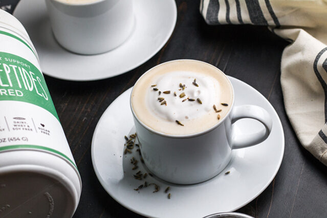 London fog latte in a white mug topped with frothed milk and lavender buds, Primal Kitchen Collagen Peptides