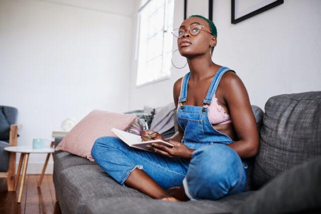 woman journaling goals