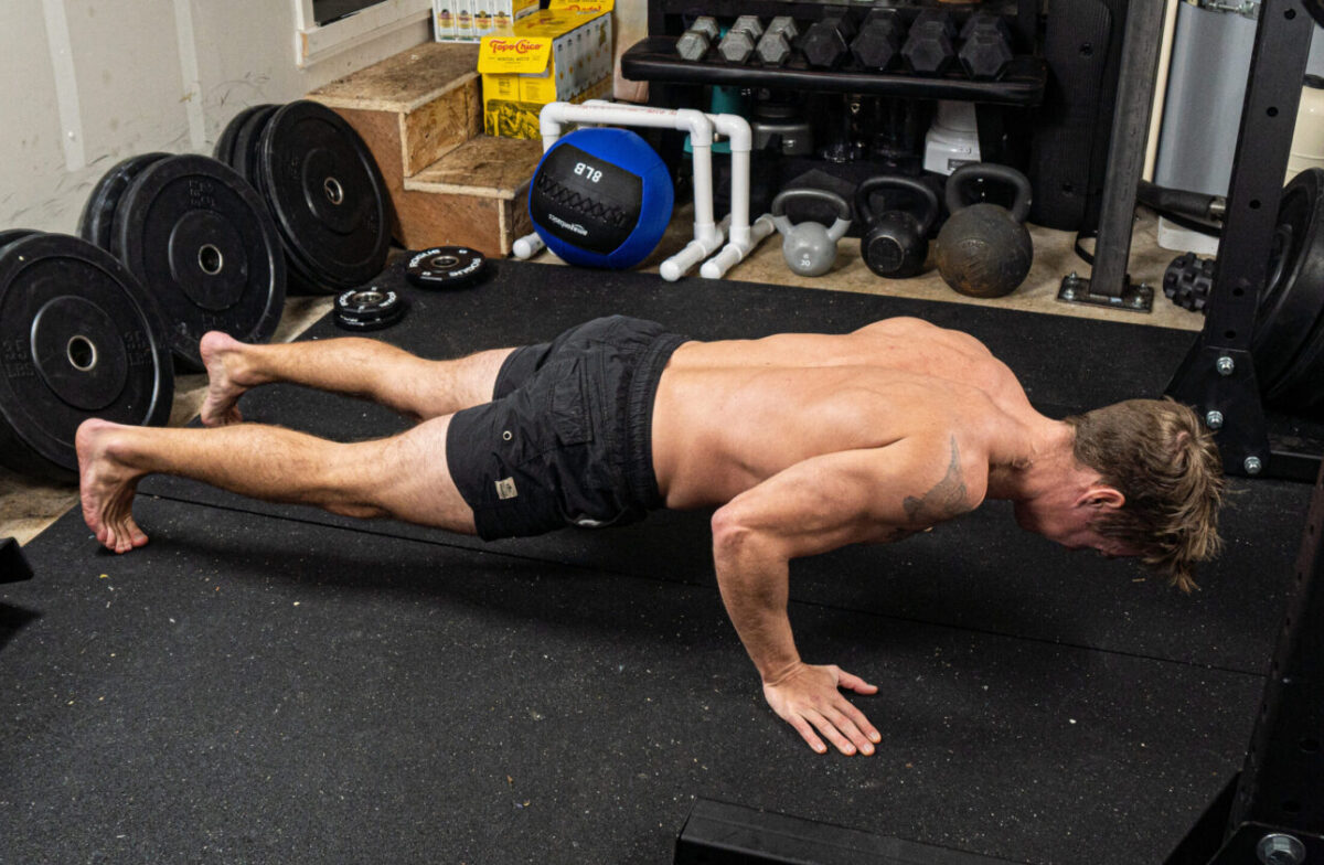 health coach showing proper push-up form