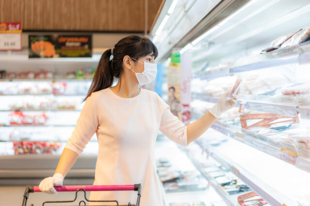 woman buying meat at the grocery store