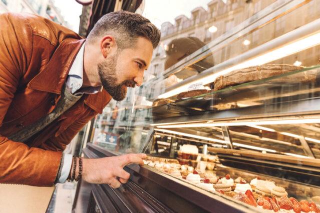 man choosing from a bakery case