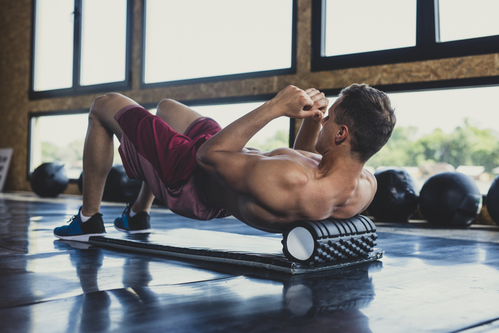 athlete using foam roller for recovery