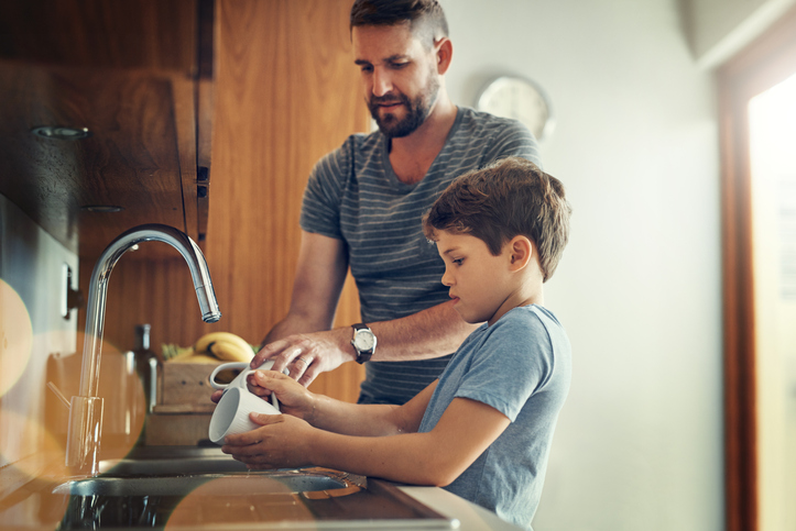 father son using diy natural cleaners