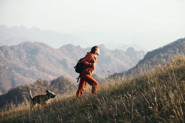 woman hiking uphill