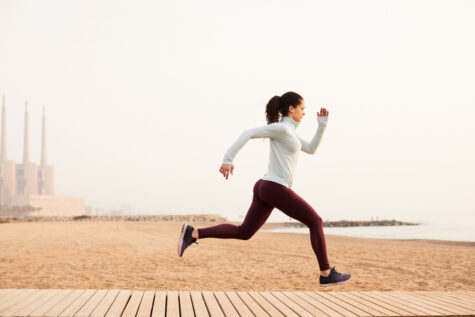 woman doing a sprinting and jumping drills workout