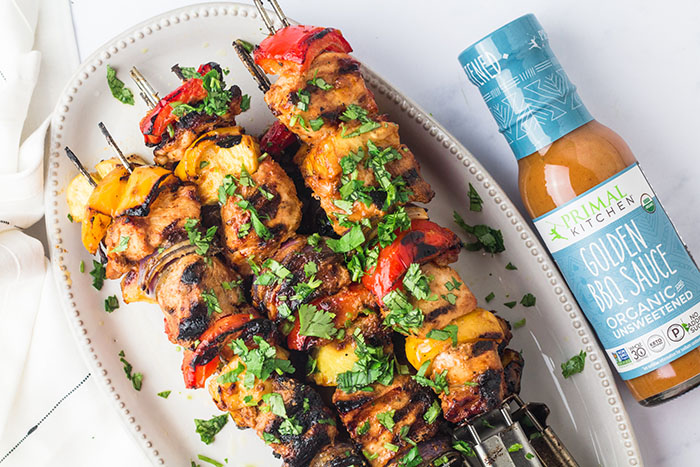 pork pineapple bbq kebabs skewers on a platter with golden bbq sauce