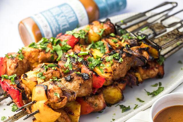 pork pineapple bbq kebabs with golden bbq sauce on a platter