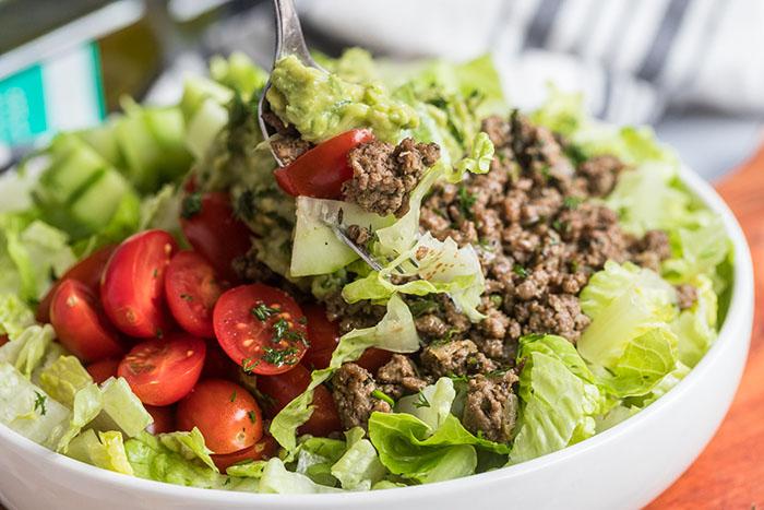 gyro taco salad with tzatziki guacamole recipe in a bowl