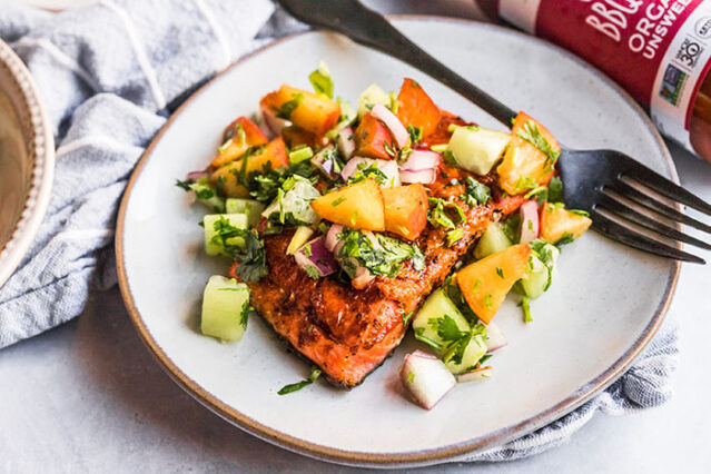 finished grilled bbq salmon recipe with peach cucumber salsa on a plate