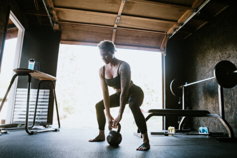 home workout in a home gym with basic equipment