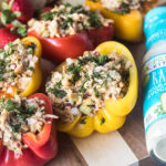 buffalo chicken stuffed peppers next to bottle of ranch dressing