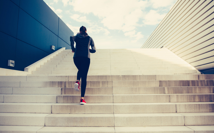 woman climbing stairs demonstrating don't give up