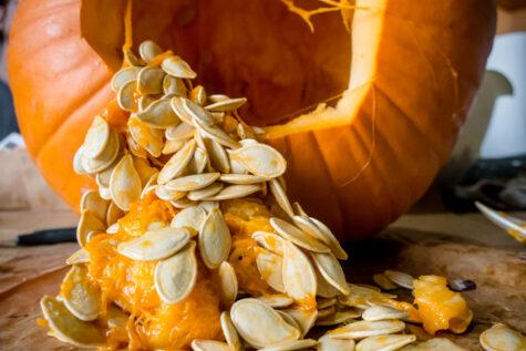 cut open pumpkin showing seeds and benefits of pumpkin