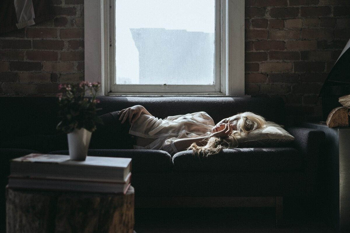 woman napping on the sofa