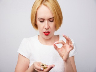 woman takes a pill