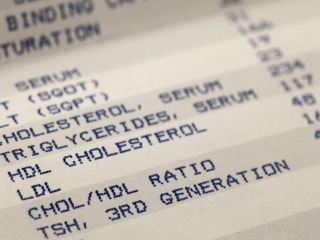 detail of blood screening results prinitng with focus on cholesterol