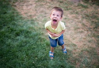 kid shouting and crying during a temper tantrum