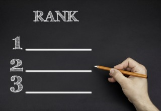 Hand with a white pencil writing: Rank blank list