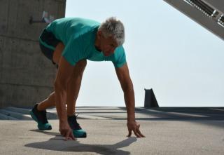 Elderly man practicing sports on the street