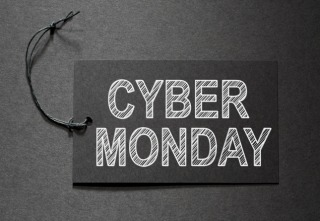 Cyber Monday text on a black tag on black paper background